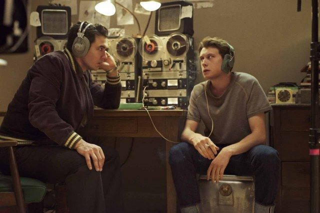 Jake (James Franco) and Bill (George MacKay) listen to recordings of Lee Harvey Oswald's conversations in a scene from 11.22.63.