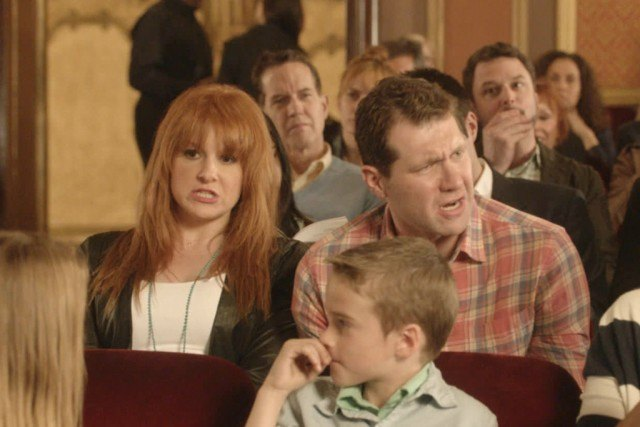 Julie Klausner and Billy Eichner sit next to each other while making disgusted faces in Difficult People
