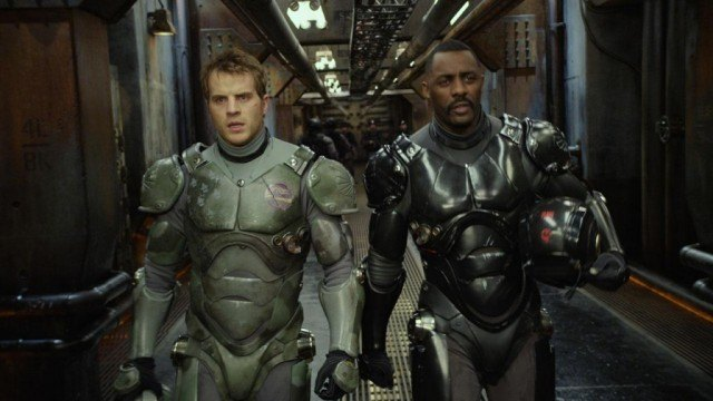 Dr. Newton Geiszler (Charlie Day) and Stacker Pentecost (Idris Elba), ready to go to battle in 'Pacific Rim'