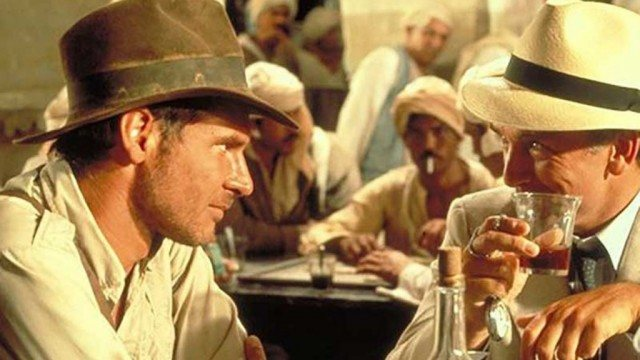 Indy (Harrison Ford) and Rene Belloq (Paul Freeman) share a tense moment during 'Indiana Jones and the Raiders of the Lost Ark'