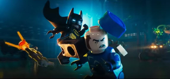 Batman kicks a bad guy in a scene from 'The LEGO Batman Movie'