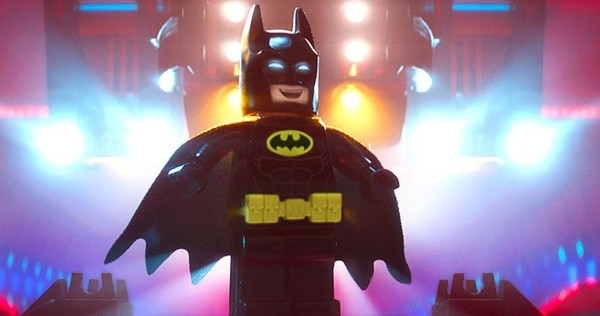 Batman looks happy during a scene from 'The LEGO Batman Movie'