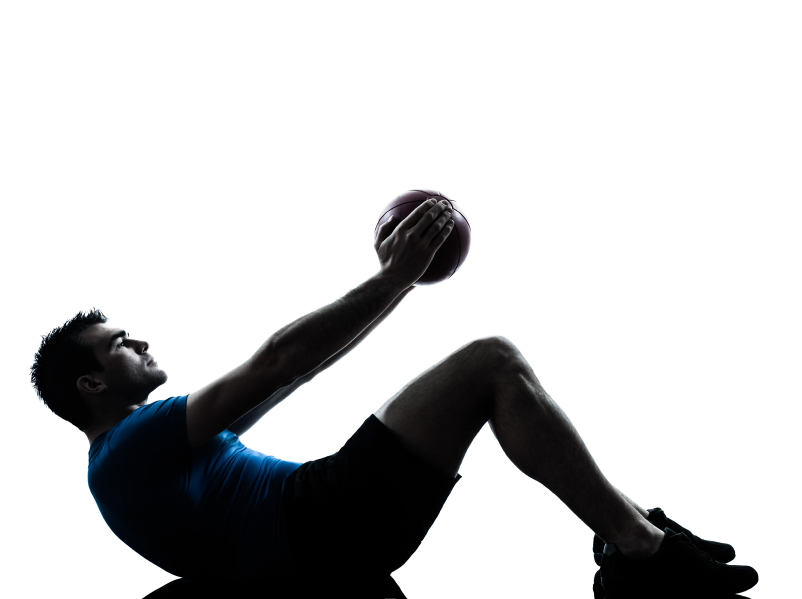man excercising with a fitness ball