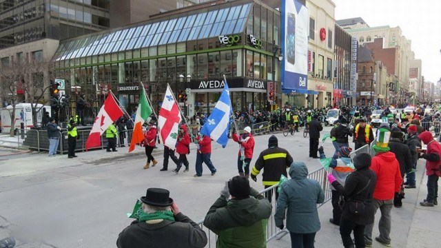 People marching with flags in Montreal's St. Patrick's Day Parade
