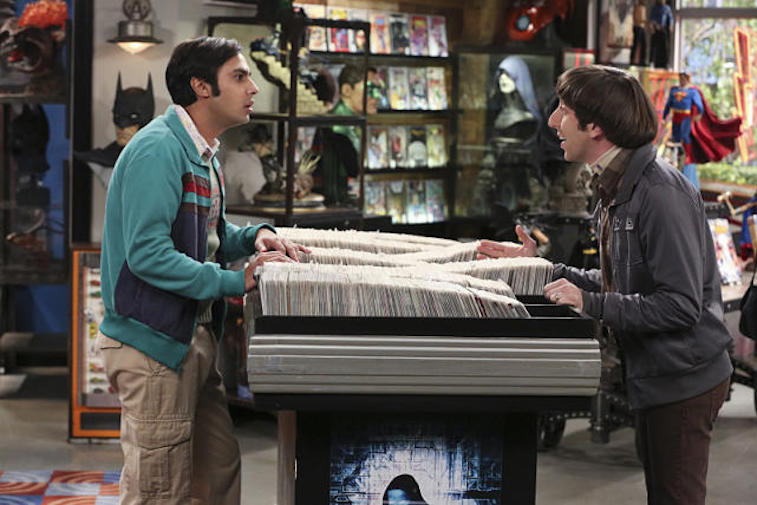 Howard and Raj stand across from each other in a comic book store