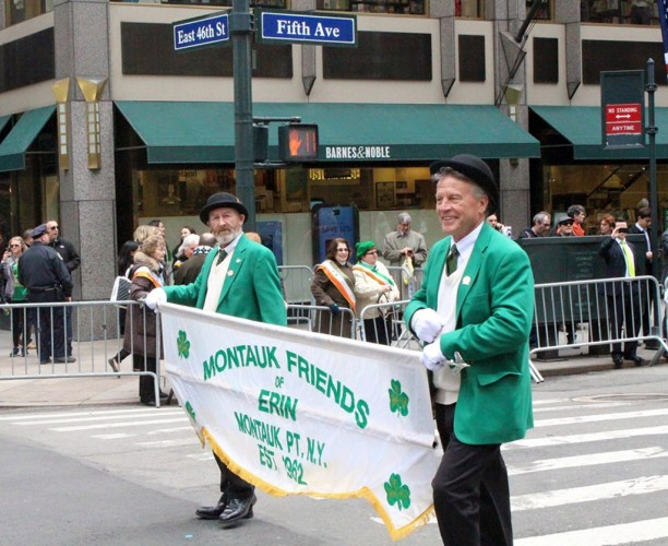 Group of men carrying a banner in New York City St. Patrick's Day Parade