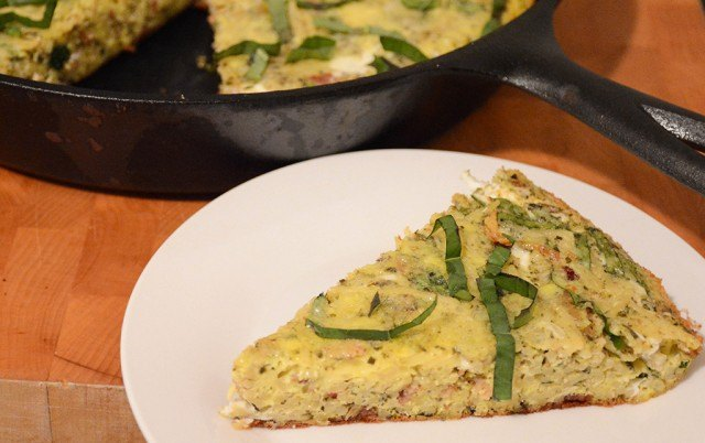 bacon, pesto, and pasta frittata cut into wedges