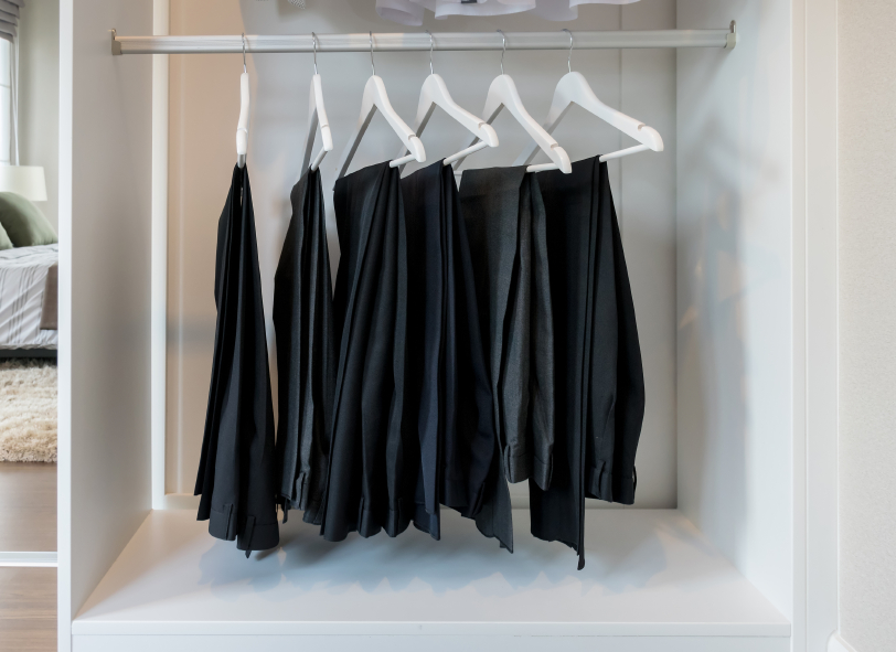 wardrobe with pants on hangers