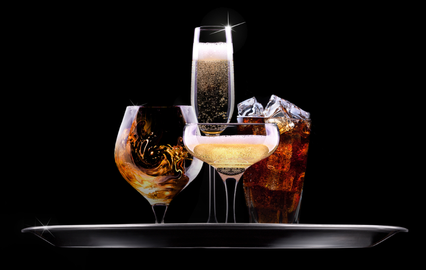 four different alcoholic drinks in glasses