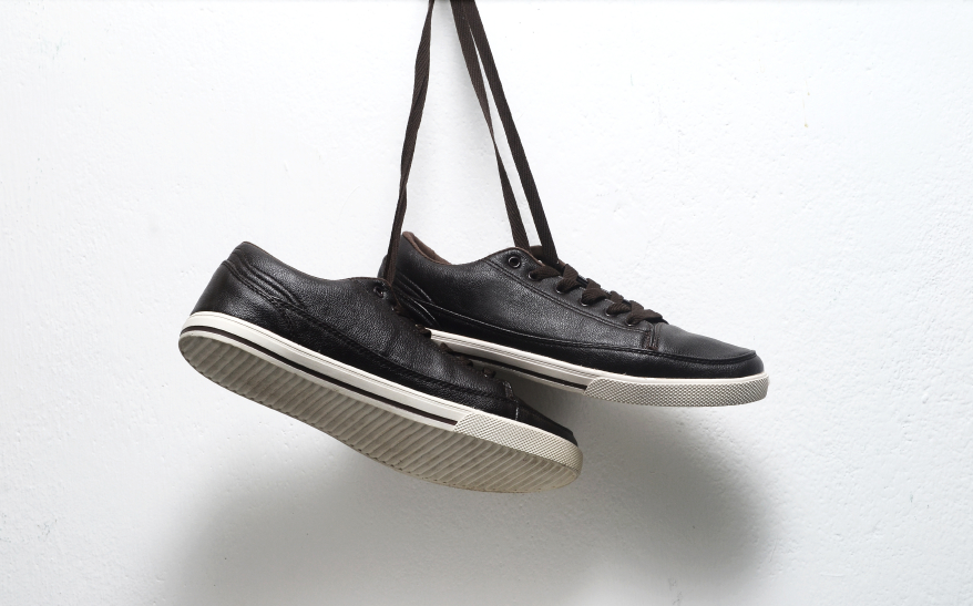 two black shoes hanging from laces