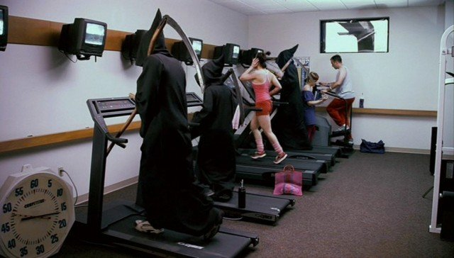 Grim reapers run on treadmills in a scene from 'Dead Like Me'