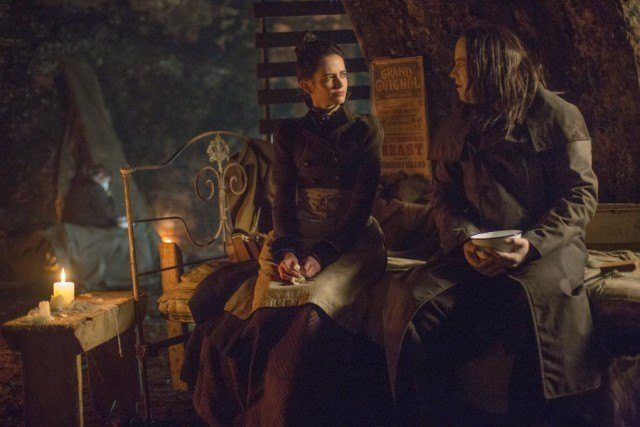 Vanessa (Eva Green) and The Creature (Rory Kinnear) sit side-by-side on a bed in 'Penny Dreadful'