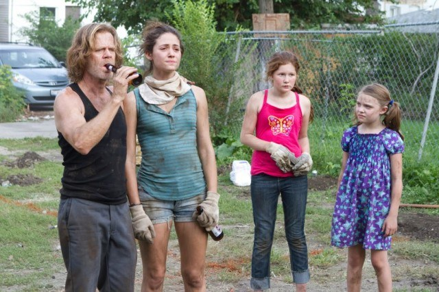 The Gallagher family stand outside, looking a bit worse for wear, in a scene from 'Shameless'
