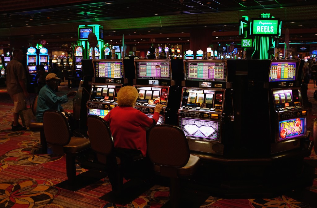woman playing slot machines in Atlantic City