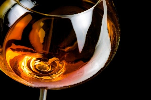 close image of a snifter with brandy
