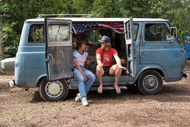 Two friends sit in a rusted out van in a scene from Richard Linklater's 'Everybody Wants Some'
