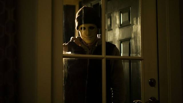 A sinister figure stands at the door in a scene from 'Hush'