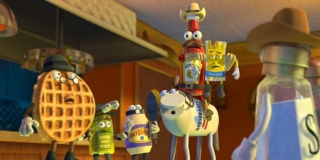Computer-animated food stand together and look concerned in a scene from 'Sausage Party'