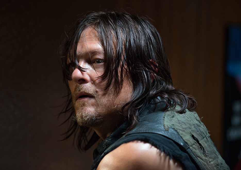 Daryl looks over his shoulder