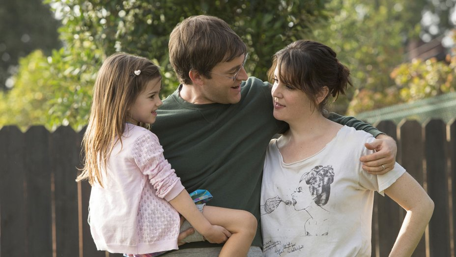 Mark Duplass and Melanie Lynskey stand in a backyard in a scene from Togetherness