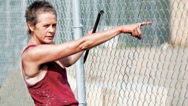 Carol Peletier (Melissa McBride) stands at the prison fences in a scene from 'The Walking Dead'
