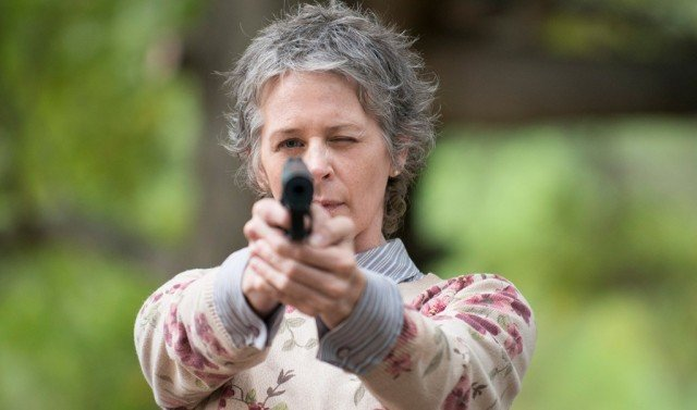 Carol Peletier (Melissa McBride) aims a gun in a scene from 'The Walking Dead'