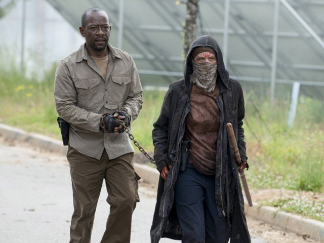 Morgan (Lennie James) and Carol (Melissa McBride) walk together in a scene from 'The Walking Dead'