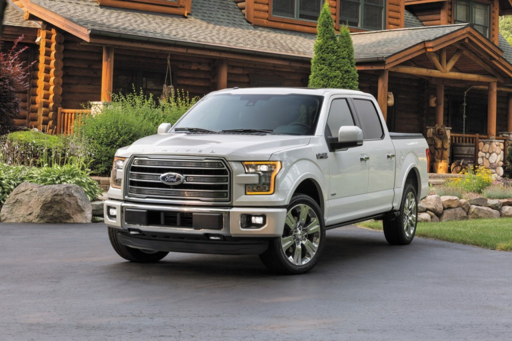 A 2016 Ford F-150 truck sits parked in the driveway