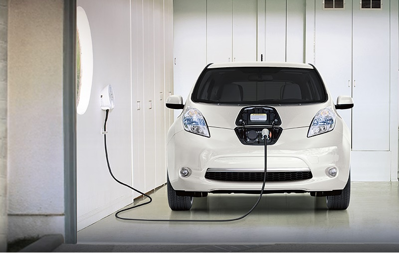 View of 2016 Nissan Leaf charging at a home