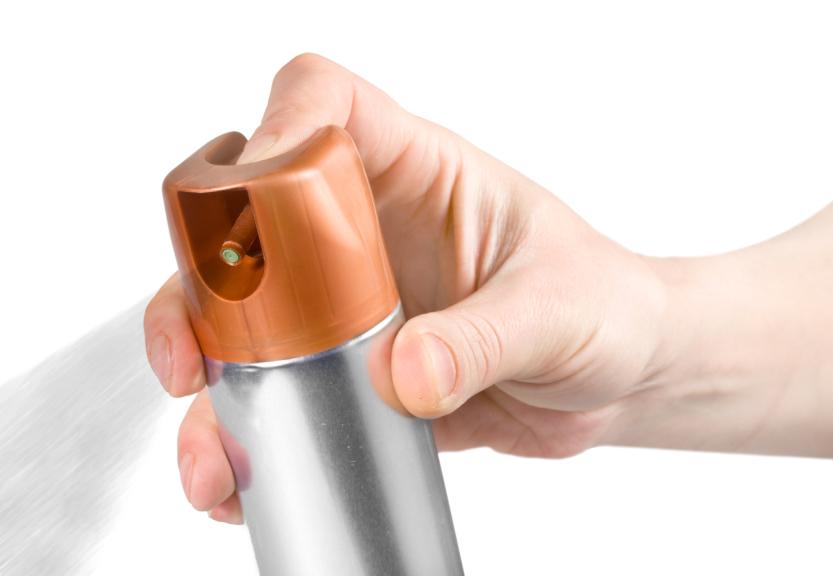 man spraying through spray bottle