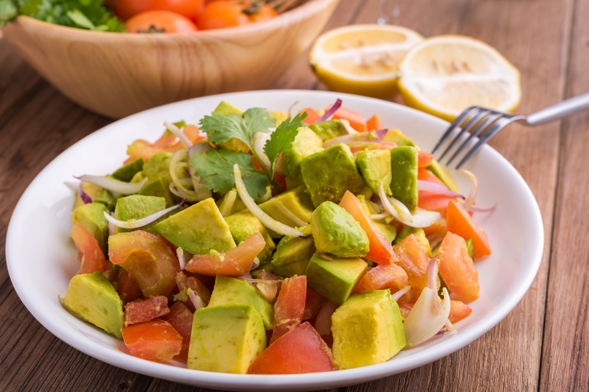 Avocado salad with fork