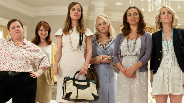 The cast of 'Bridesmaids' is lined up in a bridal store.