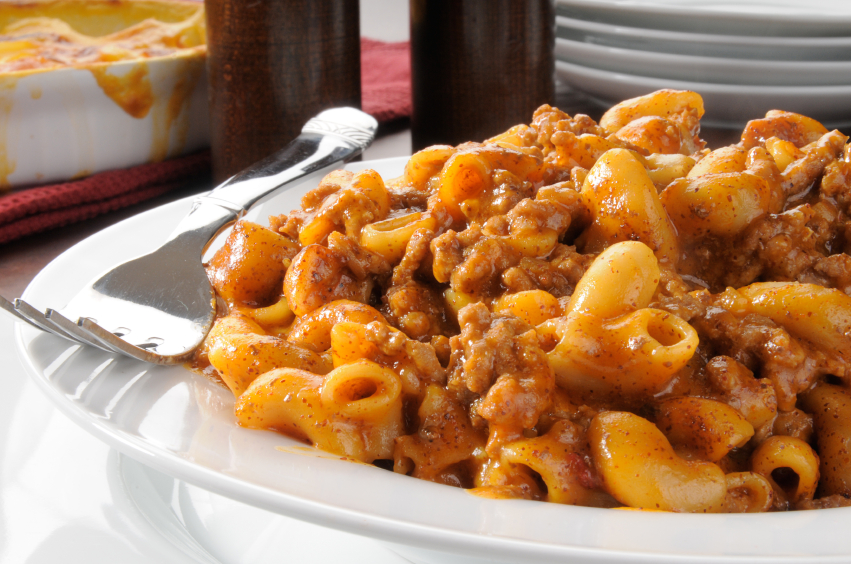 Chili mac in a whitel pllate with fork