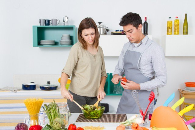 Couple making salad together in the Kitchen