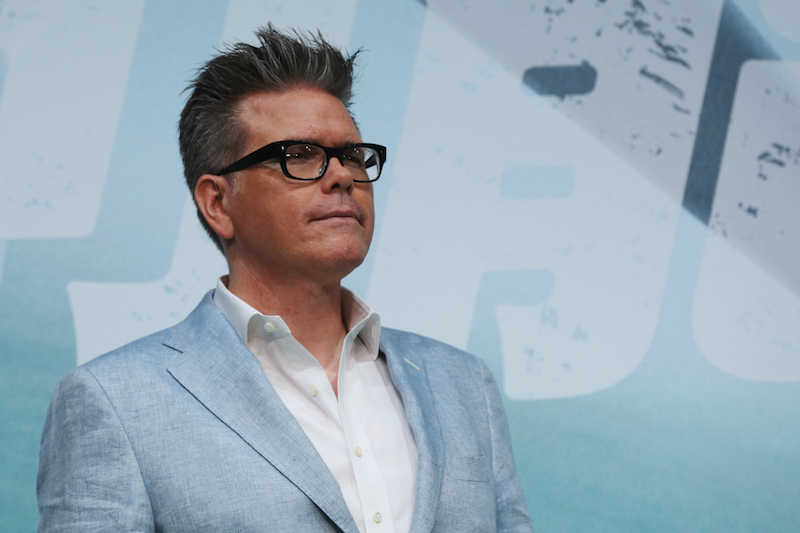 Christopher McQuarrie poses on the red carpet