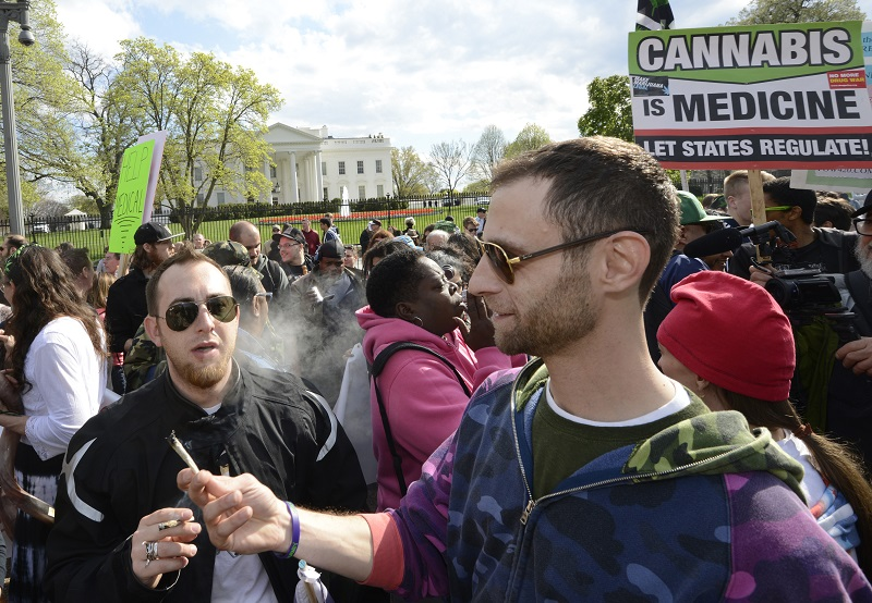 Advocates for the legalization of marijuana light up in front of the White House during a demonstration