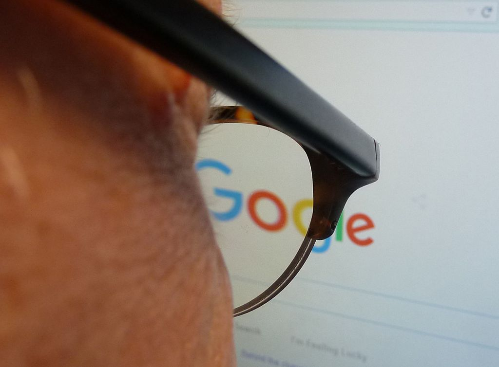 A man looks at his search history on Google