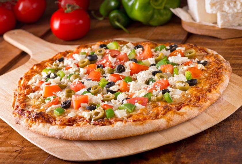 Greek Pizza on a wooden board