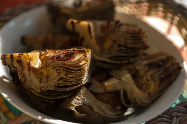bowl filled with freshly grilled artichokes