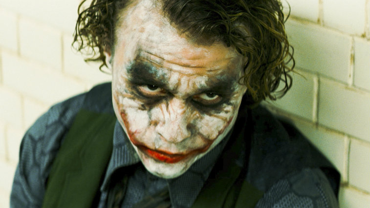 The Joker with some of his makeup off is looking up in The Dark Knight.