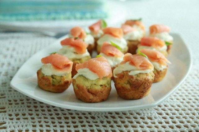 spinach mini muffins with smoked salmon on a white tray