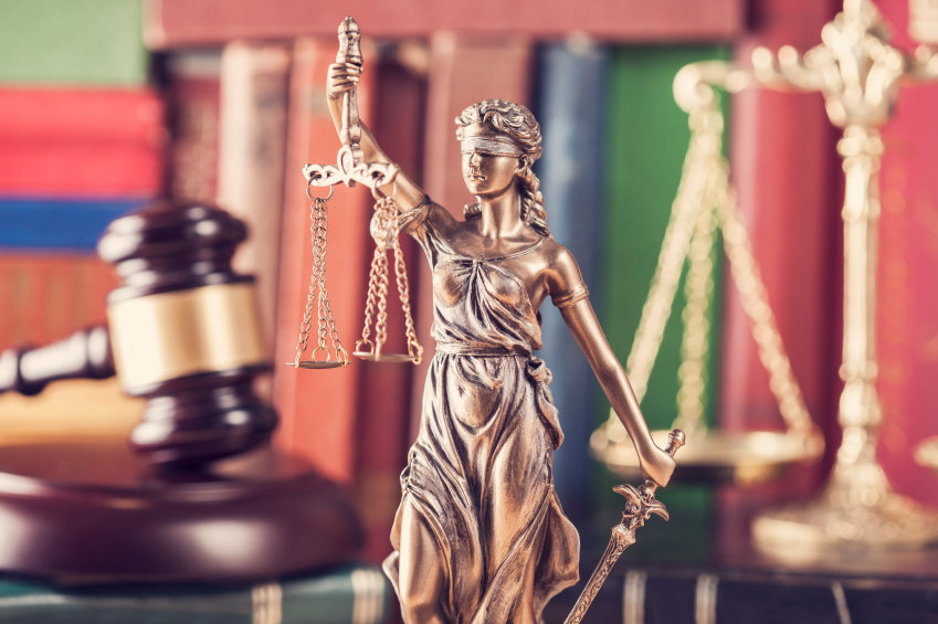 A statue, gavel, and law books