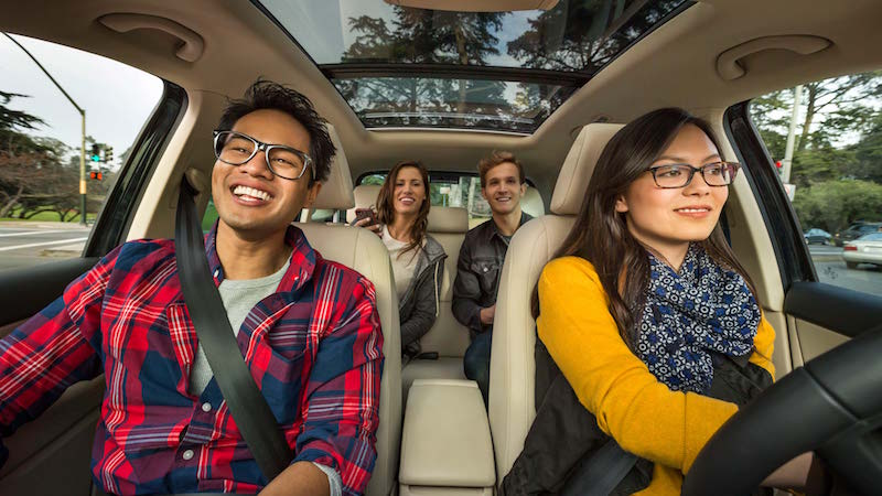 Interior view of a Lyft driver and his passengers