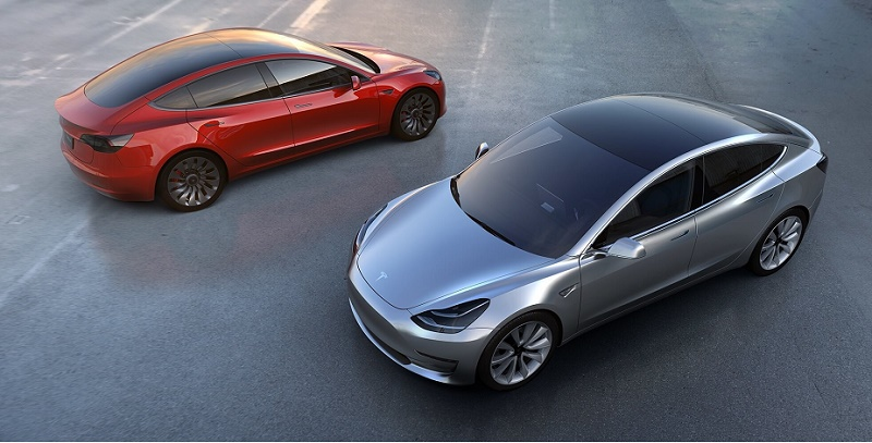 Debut version of Tesla Model 3 in red and silver