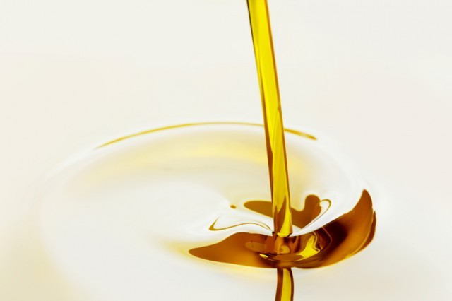 Oil pouring on a white background.