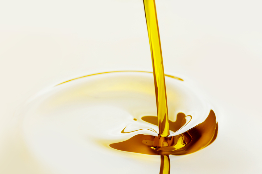 oil pouring on a white background