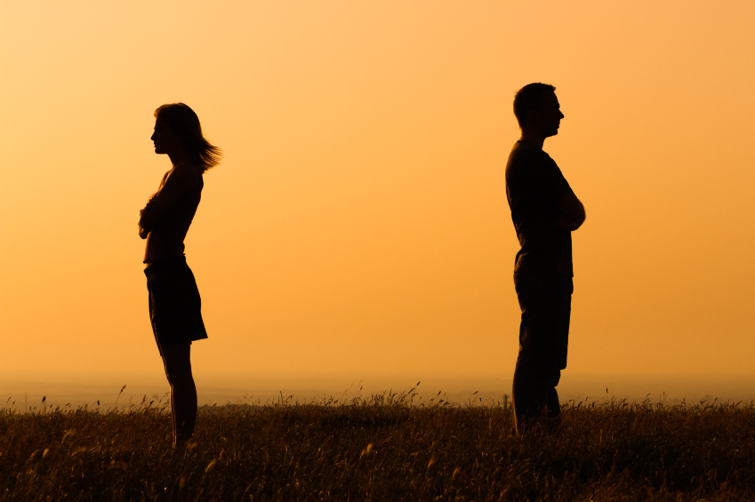 man and woman facing opposite to each other