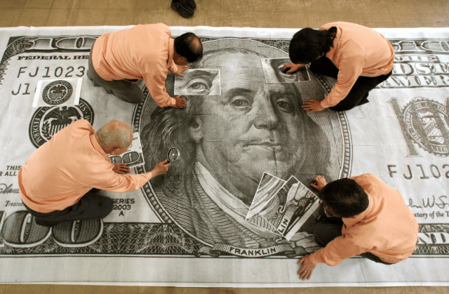 people on giant $100 bill