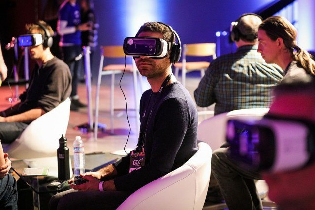 Man testing Samsung Gear VR with a group