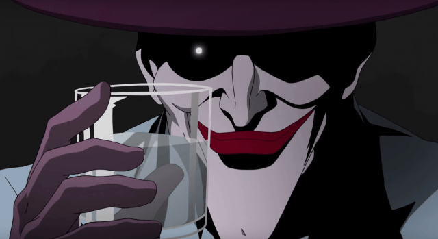 The Joker holding up a glass and smiling.